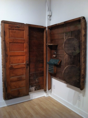 Old outhouse door, seats, wall
